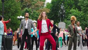 hillary clinton pantsuit flash mob hits nyc rowlson hall and her partners reached out for dancers on social media and she then videotaped herself performing the steps and sent the tape along to the