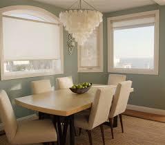 pretty white capiz shell chandelier hanged above the white dining table set for dining room design capiz shell lighting fixtures