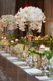 day orchid decor: white centrepieces were oh so chic at this mandy bryant dewey seasons hotel austin