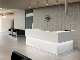 the gradual extinction of the traditional company receptionist from the front office often replaced by a cheap silver bell or telephone was the modern office reception desk