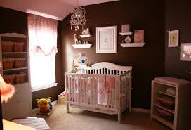 baby girl nursery with dark chocoloate painted wall with white nursery furniturepng baby nursery furniture white