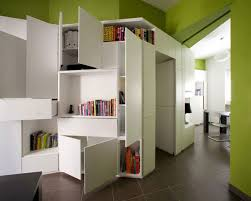 M  Astounding Modern Small Apartment Compact Furniture Interior Design With Walls Painted Of Green Also White Laminated Bookshelf Cabinet Storage And Round