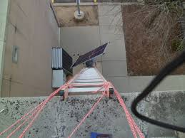 solarypsi ypsilanti michigan carrying panels up the ladder