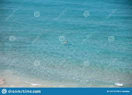 Young Woman <b>Relaxing</b> On The Blue <b>Transparent</b> Sea Surface ...