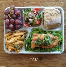 photos of school lunches served around the world reveal how meager balanced diet italian children get pasta fish two kinds of salad rocket