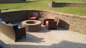 paving gorgeous brick patio with retaining wall and brown resin wicker outdoor chairs also orange garden brown covers outdoor patio