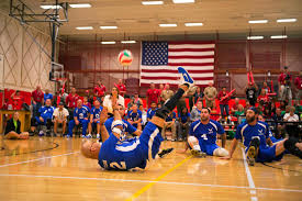 u s department of defense photo essay air force sitting volleyball team player christopher aguilera foreground returns a serve from the