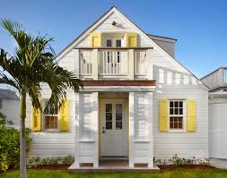 allamanda cottage inspiration for a beach style white two story wood gable roof home in toronto beach house decor ideas beautiful beach homes ideas