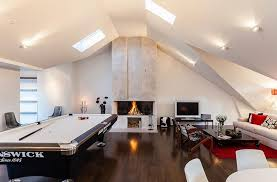 view in gallery beautifully lit attic game room attic lighting ideas