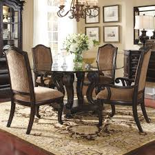 kitchen pedestal dining table set: dark brown wooden base carving with shelf for round glass top table plus dark brown