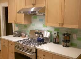 varnished wood kitchen cabinet blue glass