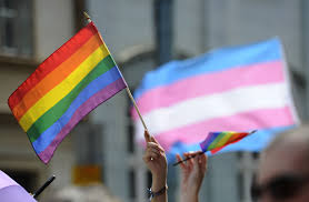 here s what trans people are saying about north carolina s anti people hold up rainbow flags during an lesbian gay bisexual and transgender lgbt