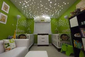 kids bedroom lighting idea with ceiling starlights and wall decor on green wall paint color bedroom lighting tips