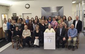 business of the week finger lakes federal credit union business gene front row center and bob front row second from right mcfadden pose for a photo staff at finger lakes federal credit union in geneva