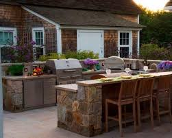 patio outdoor stone kitchen bar: rock bar with wooden top contemporary outdoor kitchen design in backyard with stone backsplash