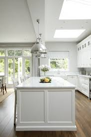 Very High Ceilings With Light Glazed Top Boxes Make This Kitchen Impressive The Dark Wooden Floors The Cabinetry And Marble Worktops