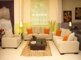 add orange accent in cream feng shui living room with unique coffee table and cream sofas bedroom cream feng shui