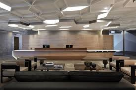 a light palette of limed oak pale timber flooring and golden marble as seen anz office melbourne