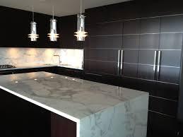 calacatta marble kitchen waterfall: contemporary kitchen with complex marble calacatta classic marble countertop pendant light kitchen island