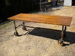7ft dining table: histories ft table made with recycled woodpipes and casters dining room