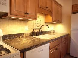 glow yellow lights with stylish sense with beautifies the mosaic tile backsplash cool under counter lights cabinet lighting backsplash