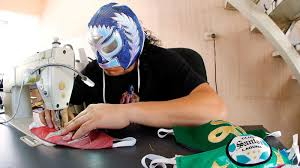 <b>A Mexican</b> 'Lucha Libre' Wrestler Is Sewing <b>Masks</b> To Fight ...