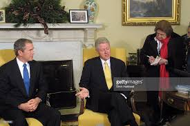 president bill clinton right meets with president elect george w bush in bill clinton oval office