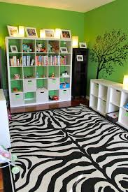 awesome green wall paint kids bedroom ideas with white wooden wide shelves above wood floor and black white zebra bedrooms