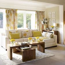 classy white leather sectional sofa with yellow accent pillow also brown wooden coffee beige sectional living room