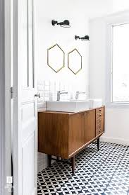problem with using old cabinets or dressers into bathroom vanities is that they are often the wrong height gotta doublecheck for that when considering that bathroom mid century