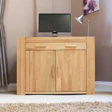the atlas solid oak hidden home office desk captures the popularity of oak furniture featuring chunky oak construction complemented with contemporary lines atlas chunky oak hidden home office