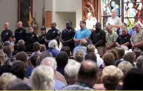 white catholics have to talk about race and to admit their racism police officers attend a 17 vigil at st john the baptist church in zachary