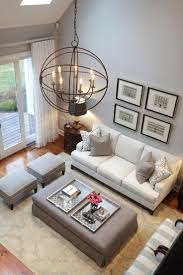 lighting living room complete guide: high ceilings and stylish design this living room uses a beautiful palette of soft gray