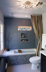funky bathroom lights: the funky light fixture pulls it all together