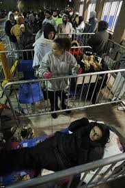 black friday madness as two people are shot at a chattanooga shoppers wait for doors to open at walmart in dartmouth massachusetts on black friday as