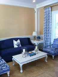 blue sofas living room: coastal inspired yellow living room is classic elegant