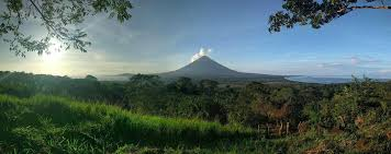 my new job in an eco village on a volcano how we get to next a month ago i was newly unemployed and unchained in the panhandle of florida now i live in an eco village on a volcano in the middle of a lake in