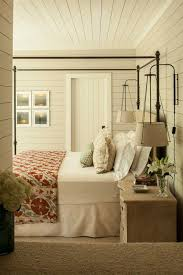 farmhouse bedroom with shiplap walls bedroom sconce lighting