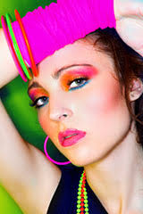a woman that is wearing a lot of 80s style makeup