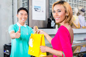 customer and shop assistant in asian fashion store giving thumbs customer and shop assistant in asian fashion store giving thumbs up stock photo 37893673