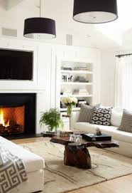 this living room includes many decorative and functional pieces of furniture in an attractive white color pendant lighting living room