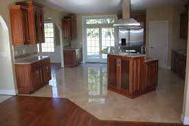 kitchen floor tiles small space: spacious kitchen with granite floor tile also brown wooden cabinet