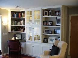 wall storage shelves office shaed study desk attached on orange painted wall as well as wall bookshelf file storage wall