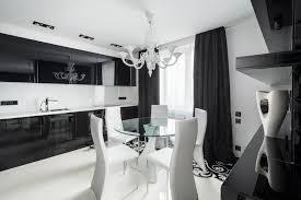 black and white modern kitchen design with dark kitchen cabinetry with white ties backsplash and clear black white modern kitchen tables