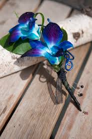 day orchid decor: silk blue and purple dendrobium orchids tie dye boutonniere  as shown