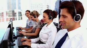smiling business people working in a call centre royalty call center