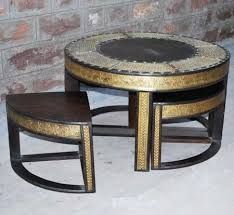 this compact antique oak wood coffee table set with embossed brass trimmings from jodhpur based sujan art is another popular design making rounds in the brass and metal furniture