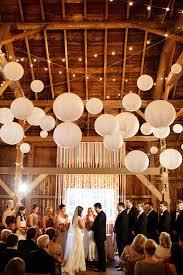 indoor barn wedding decor ideas with paper lanterns and string lights barn wedding lighting