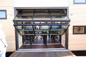 Image result for custom glass garage door installation