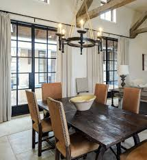 chair dining tables room contemporary: nailhead dining chairs dining room contemporary with antique spanish oak table image by katie galliano interiors